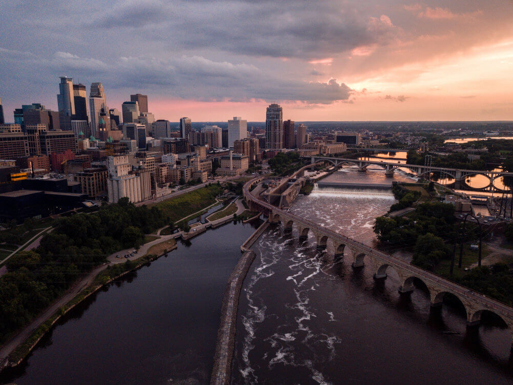 A bird's eye view of the Minneapolis Stone Arch Bridge and city buildings